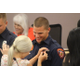 Jared Thomas' wife presents his Sandy Firefighter badge during the swearing-in ceremony at the Sandy City Council Chambers on June 28, 2016. (Photo: Chris Larson, Sandy City Journal)