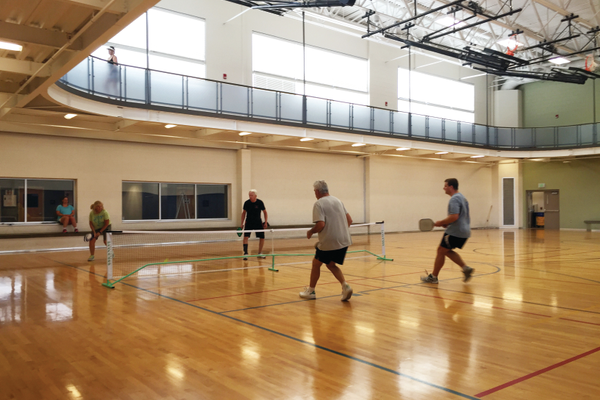 Advanced pickleball players volley during their final Friday match. Residents around the Holladay community are encouraged to drop by and try out the sport Monday through Friday from 8 a.m. until 11:30 am. —Sarah Almond