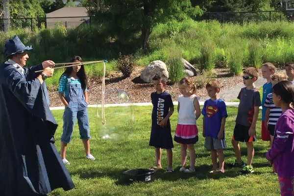 Kids learn about aerospace using giant bubbles. —Rhett Ogden