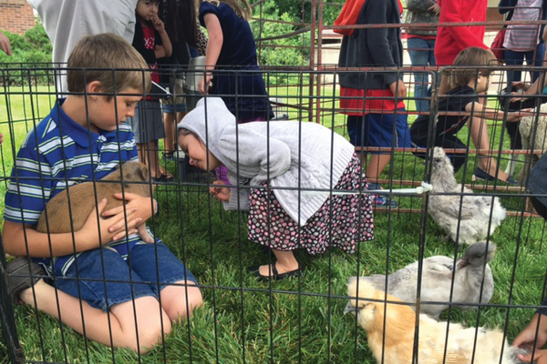 Kids had the opportunity to interact with animals at a petting zoo set up in front of the Tyler Library on Saturday, June 11. —Liz Sollis