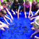 Silver Mesa fourth-graders tried plucking fish with their bare hands on May 24 during the school's second annual Mountain Man Rendezvous. — Julie Slama