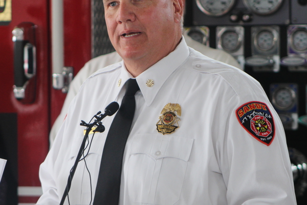 Sandy City Fire Chief Bruce Cline speaks at the press event announcing the release of ParentsEmpowered videos featuring Sandy firefighters and the display of anti-underaged drinking graphics on various Sandy firefighting vehicles at Sandy City Fire Station 31 on June 30, 2016. (Photo: Chris Larson, Sandy City Journal)