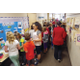 Hawthorn students review the presentations of fifth-graders who showed their projects from International Baccalaureate's primary years program. — Julie Slama