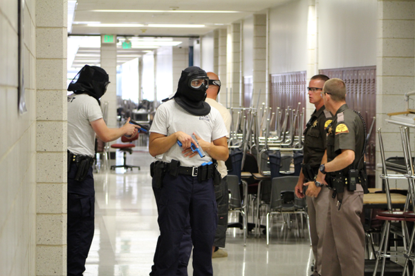 Cadets conclude shooter drill under the supervision of Utah Highway Patrol's Sgt. Andrew Prescott and Trooper Scott Attridge in at Jordan High School on July 5, 2016. (Photo: Chris Larson, Sandy City Journal)