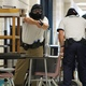 """A Peace Officer and Standards Training cadet acts as cover for members of his squad detaining Utah Highway Patrol Trooper Daniel Krum who acted as an """"active shooter"""" at Jordan High School on July 5, 2016. (Photo: Chris Larson, Sandy City Journal)"""
