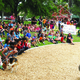 Dozens of kids from elementary to high school age listen to the speakers during the grand opening of the Fairmont Park playground on June 10. —Travis Barton