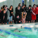 Members of the Rams swim team urge their teammate on as she makes her turn at the wall. —Cindy Nordstrom