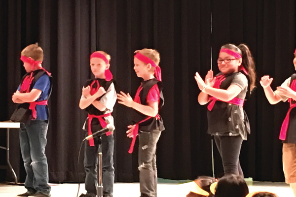 Students introduce their self-written opera at Arcadia Elementary School. The students created the opera through Utah Festival Opera & Musical Theatre's Opera by Children program. – Tori La Rue
