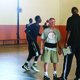 Barry Hecker (center) uses his basketball knowledge to help teach students in Senegal. –SEED