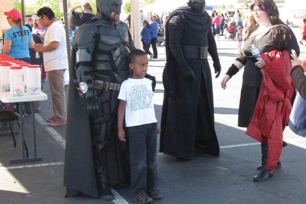 Members of the Kids Heroes Foundation dressed up as famous pop culture characters like Batman and Kylo Ren to take photos with kids. —Travis Barton