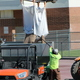 FieldTurf employee Cole cuts a bag of fine washed silica sand to be used as a base fill for the new Jordan High School turf field. (Photo: Chris Larson, Sandy City Journal)
