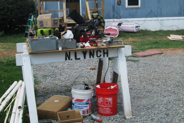 A plumber's workbench outside the Blevins home.