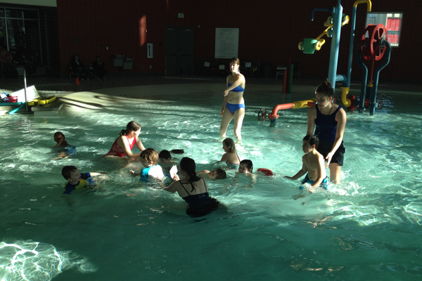Instructors Kelly DeLeon and Ivy Hausknecht oversee the group of children ages three through 18 as they practice floating. Drowning is the number on cause of death for children with autism and Otters works with swimmers on vitals skills like floating and turning from stomach-to-back so they are prepared to be safe in the water.—Sarah Almond