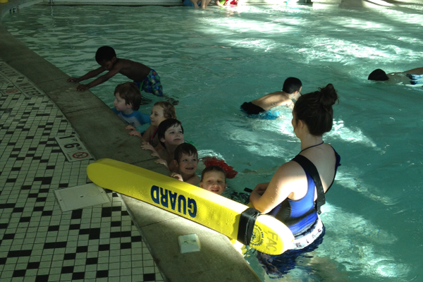 Otter instructor Kelly DeLeon lines several memebers up at the beginning of a one-hour practice. As an adaptive program for children with intellectual disabilities, Otters teaching swimmers fundamental life-saving water skills and how to be comfortable in the water. –Sarah Almond