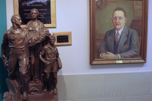 "Near the Draper Elementary principal's office is the bronze statue, ""New Life & New Frontiers,"" by Utah sculptor Avard Fairbanks. Looking over it is a portrait of Principal Reid Beck, who began the school's art collection in the 1920s. — Julie Slama"