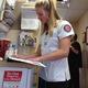 Hailey Karg checks a chart while volunteering at the Hope Clinic. –Travis Barton