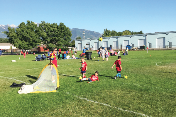 A few players from the Kindergarten Team practice before playing a Tuesday night game. Along with weekly games, coaches hold practices once a week to teach young players the basics and practice the fundamentals of soccer.
