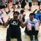 Riverview Junior High students joins members of the Utah Jazz stunt team doing sit-ups during the May 5 Utah JazzFit program. — Julie Slama