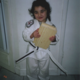 Earned her little ninja black belt at age 4 and broke her first board with her foot.