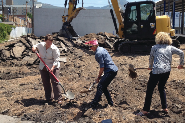 Amy Barry, Sugar House Community Council Chair, (left) along with City Councilwoman Lisa Adams and Mayor Jackie Biskupski commence the demolition of the Ute Car Wash by shoveling dirt on July 6. –Travis Barton