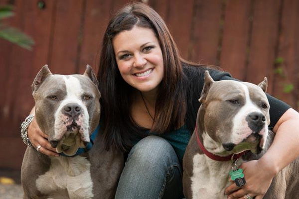 Fresno Bully Rescue Shelter Director, Bridgette Boothe, with two of her pups.