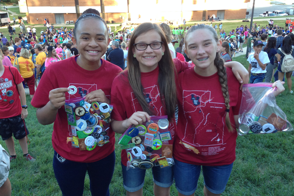 Angel Lui (left), Gabby Proctor and Regan Turner show off their buttons during the opening ceremonies of the National History Day Competition. Each state designs a button with the goal to collect one from each participating state.