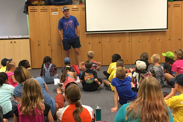 Ted Ligety, the youngest American to claim an Olympic Gold Medal in Alpine skiing, shares the story of how he became a professional athlete to children at the YMCA Community Family Center in Taylorsville. –Tori La Rue