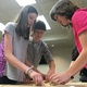 Teens work together to build an earthquake resistant foundation out of KEVA planks during a summer STEM camp at the Taylorsville Library –Tori La Rue