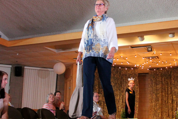 Eileen B. models clothes from J. Jill during the annual Maple Grove Fashion Flair August 18, 2016 at the Maple Grove Community Center. (Photo by Doug Erlien)