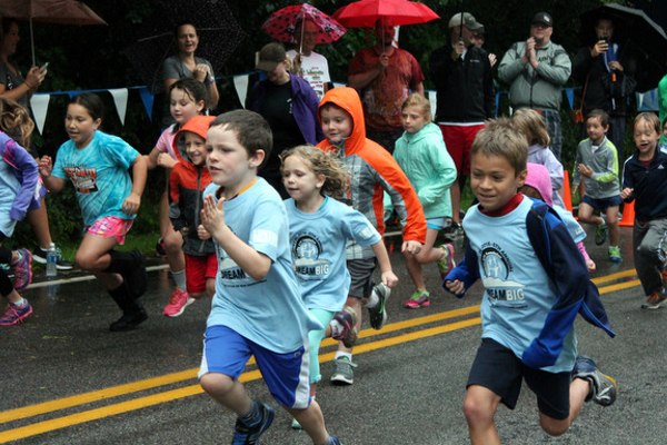 Participants dodged a little rain in the District 279 Foundation's Reading is Fun 1k Run/Walk on Saturday, Aug. 20 at Elm Creek Park Reserve. (Photo By: Wendy Erlien)