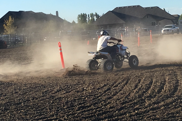 An ATV rodeo contestant zips zigzags through cones during Bluffdale's Old West Days celebration. –Tori La Rue