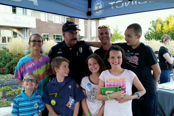 Abbey Pulley, Conner Fitzgerald, Colten Fitzgerald, Katie Fitzgerald and Tom Pulley pose for a picture with Unified Police Department officers. –Tifanie Fitzgerald