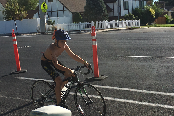 A boy pedals down 2700 West by the Taylorsville Fitness and Recreation Center during the center's fifth annual triathlon. –Tori La Rue