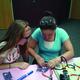 Cassandra Ivie (Right) helps another student solder a LCD screen. –Cassandra Ivie
