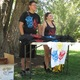 Jaxyn Henderson and Samantha Lemon sell T-shirts at the park highlighting each team within the Pokémon Go game. There are three teams of different colors: Valor (red), Mystic (blue) and Instinct (yellow).  –Travis Barton
