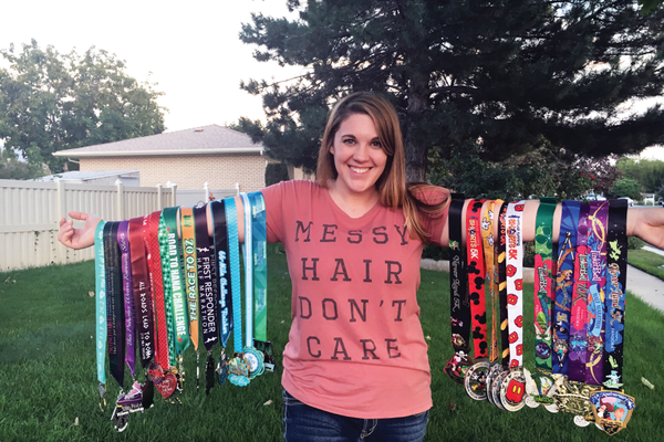 April Norton proudly displays her many metals. (Patricia Donohue/Resident)