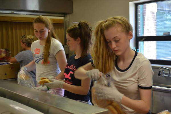 Teens make sandwiches during a service project through Utah Ulster Project, a program with a goal to fosters friendships between Catholic and Protestant teens from Northern Ireland. --Utah Ulster Project