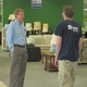 Kevin Smith talks with an employee of the Middletown ReStore.