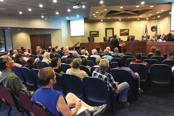 Jim Welch, finance director, gives a presentation of the city budget during the city council meeting on Aug. 8. The city council voted to adopt the 2016-2017 fiscal budget, which includes a nine percent property tax increase. —Travis Barton