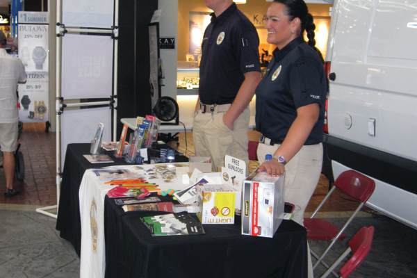 Sergeant Trudy Cropper runs an information booth with other officers during the Police Safety Fair. The safety fair was one of many events run by the city promoting National Night Out during August. –Travis Barton