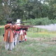 Reenactors fire a musket salute at the conclusion of the ceremony