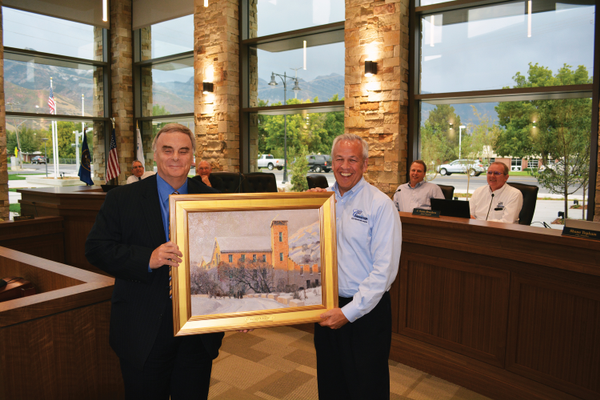 Mayor Kelvyn Cullimore accepting City Attorney Shane Topham's housewarming gift. (Dan Metcalf Jr./Cottowood Heights)