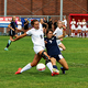 Senior striker Sadie Mertlich fights off a defender. (Michelle Porter/Resident)