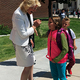 Jordan School District Superintendent Patrice Johnson greets A-track students at Riverside Elementary as they exit the building on their first day of school. (Tori La Rue/City Journals)
