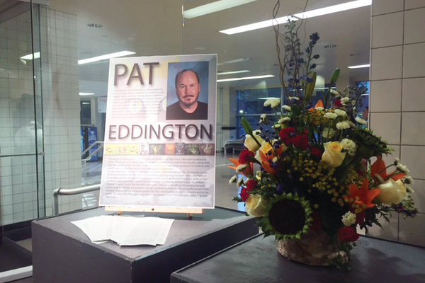 A short remembrance of Pat Eddington written by principal Jenson as people entered the gallery. (Natalie Mollinet/City Journals)