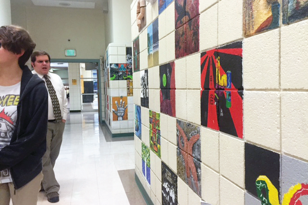 Bricks on the wall where Pat Eddington had AP students do an art piece. (Natalie Mollinet/City Journals)
