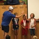 Ted Ligety, two-time Olympic gold medalist, gives Anabelle Latta, 9, a high five after presenting her with a gold medal for her second season of Alpine skiing through the Ted Ligety Learn to Ski Program. (Tori La Rue/City Journals)
