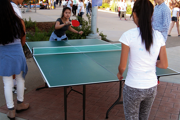 Students play ping pong at the Granger Carnival on Sept. 7. (Travis Barton/City Journals)