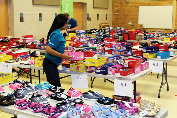 Molina Healthcare employees volunteered at Shoes for School, the company's annual back to school event. Students at Franklin Elementary in Provo and Stansbury Elementary in West Valley City received free backpacks, shoes, school supplies, health screenings and more. (Stansbury Elementary)