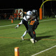 Osseo wide receiver Julian Cavin hauls in a touchdown pass against Blaine